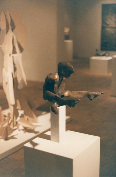 A bronze figure sculpture entitled