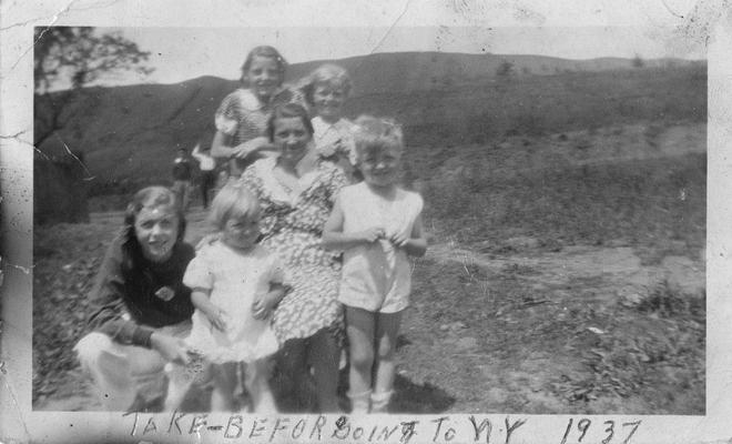 An image of John Tuska, Tuska's sisters and mother. From top to bottom, left to right: Emma; Rita; Cecilia (mother); John; Marie and Joyce