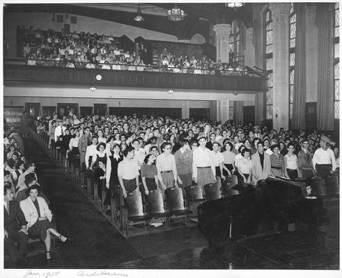 An image of John Tuska and his classmates of the New York High School of Music and Art in an auditorium