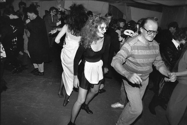 A image of John Tuska dancing with a group of unidentified persons at a costume party