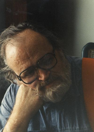 A image of John Tuska with a beard and glasses