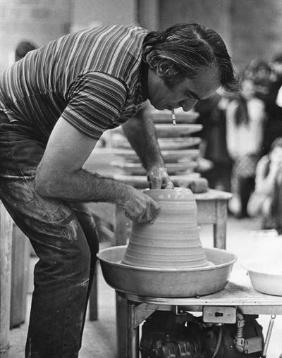 Artist Peter Voulkos demonstrating lifting clay for a class at the University of Kentucky. John Tuska was in attendance