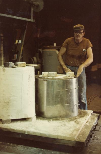John Tuska preparing molds for a foundry class at the University of Kentucky. The photograph was taken by Ted Bronda