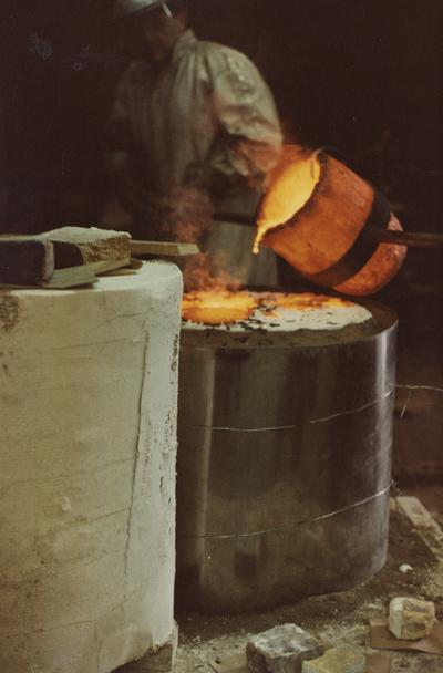 John Tuska pouring for a cast at the University of Kentucky foundry. The photograph was taken by Ted Bronda