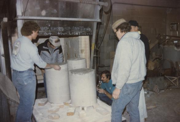 John Tuska and four students moving molds in the University of Kentucky foundry. The photograph was taken by Zig Gierlach