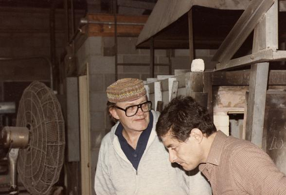 John Tuska and an unidentified student in the University of Kentucky foundry. The photograph was taken by Zig Gierlach